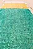 Na podłoga zielona i żółta sieć rybacka Zdjęcie Stock