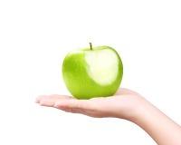 Na ręce odizolowywającej zielony jabłko Zdjęcie Stock