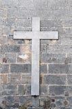 Na starej ścianie religijny krzyż Obrazy Stock