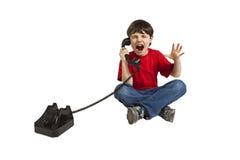 Na telefonie gniewny dziecko zdjęcia royalty free
