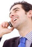 Na telefonie młody biznesowy mężczyzna Zdjęcie Royalty Free