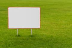 Na trawie pusty billboard Obraz Stock