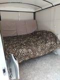 Na Zamówienie obozowicza łóżko obrazy royalty free