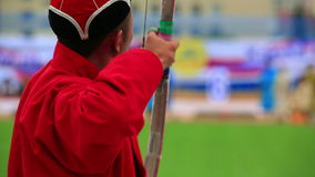 Naadam Festival Archery Tournament. Archer at Naadam Festival Archery Tournament, Mongolia stock video footage