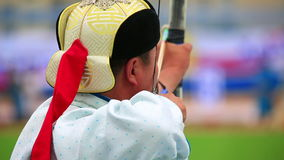 Naadam Festival Archery Tournament. Archer at Naadam Festival Archery Tournament, Mongolia stock footage