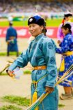 Naadam Festival Opening Ceremony Female Archer. Ulaanbaatar, Mongolia - June 11, 2007: Female archery competitor in traditional garb participating in opening Stock Photo