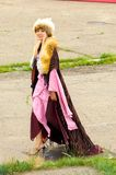 Naadam Festival Opening Ceremony Woman Fur Robe. Ulaanbaatar, Mongolia - June 11, 2007: Beautiful Mongolian woman dressed in fur and flowing robe, dress walking Royalty Free Stock Image