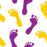 Naadloos behang met voetafdrukken Stock Fotografie