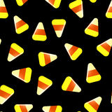 Naadloos Halloween-patroon met suikergoed op zwarte Stock Afbeeldingen
