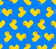 Naadloos patroon als achtergrond van gele rubbereenden Stock Foto's