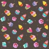 Naadloos patroon - kleurrijke cakes op een chocoladeachtergrond Stock Foto's