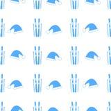 Naadloos patroon met blauwe skis en hoeden stock illustratie