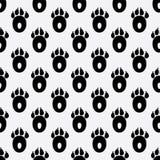 Naadloos patroon met de drukken van de honds poten royalty-vrije illustratie