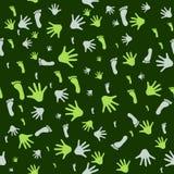 Naadloos patroon met drukken van handen en voeten Stock Afbeeldingen