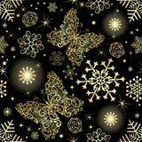Naadloos patroon met gouden sneeuwvlokken en vlinders Stock Foto