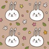 Naadloos patroon met krabbelkonijnen en bloemen Royalty-vrije Stock Foto