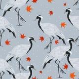 Naadloos patroon met kranen en esdoornbladeren vector illustratie