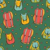 Naadloos patroon met rugzakken op groene achtergrond Royalty-vrije Stock Afbeelding
