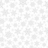 Naadloos patroon van sneeuwvlokken, grijs op wit Royalty-vrije Stock Foto's