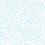 Naadloos patroon van sneeuwvlokken, lichtblauw op wit Stock Foto