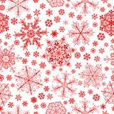 Naadloos patroon van sneeuwvlokken, rood op wit Stock Foto's