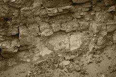 Naadloze abstracte achtergrond Barsten en lagen van zandsteen Het patroon van de geschakeerde zandsteen Geologische lagen van aar Stock Foto