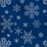 Naadloze blauwe vectorachtergrond met een patroon van witte sneeuwvlokken Royalty-vrije Stock Afbeeldingen