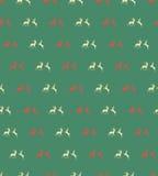Naadloze patronen met Kerstmisrendieren op bruine achtergrond Stock Afbeelding