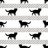 Naadloze patronen met silhouetten van de zwarte kat stock illustratie