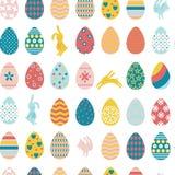 Naadloze patroonpaaseieren en konijnen vector illustratie