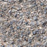Naadloze strand rotsachtige textuur met zand Achtergrond stock foto
