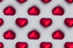 Naadloze tegel van rode harten in de sneeuw Royalty-vrije Stock Afbeeldingen