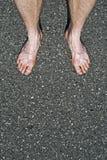 Naakte voeten op cement royalty-vrije stock foto's