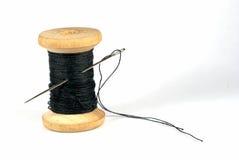 Naald en een draad Stock Afbeelding