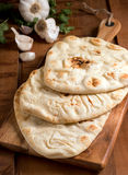 Naan Bread. Delicious fresh homemade naan bread with garlic and cilantro Stock Photo