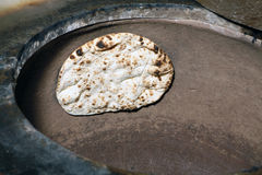 Naan in clay oven Royalty Free Stock Image