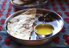 Naan flat bread with daal soup in thali Royalty Free Stock Photography