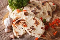 Naan flat bread with garlic close-up. horizontal Stock Image