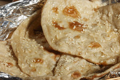 Naan is a round flatbread from India Royalty Free Stock Photography