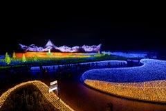 Nabana no sato winter illumination. Mie,Nagoya, Japan - November 23, 2015 : Unidentified tourist in blur motion visiting Nabana no sato winter illumination in royalty free stock photography