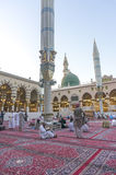 Nabawi mosque. MEDINA, SAUDI ARABIA - MARCH 09, 2015 : Pigrims rest and reading Koran after fajr pray inside Nabawi Mosque. Nabawi Mosque is the second holiest royalty free stock photography