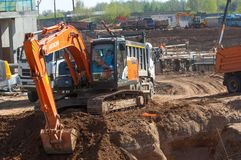 Construction, building, development, constructing. Naberezhnye Chelny, Tatarstan, Russia, Excavators digging the pit. construction, building, development Royalty Free Stock Photos