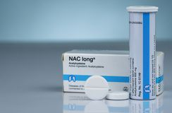 Free NAC Long Effervescent Tablets And Tube Drug Container On Gradient Background. Round White Tablet Pill. Pharmaceutical Product. Royalty Free Stock Images - 138423659
