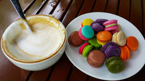 Nacaron and latte coffee. Sweet colorful garden morning Stock Image