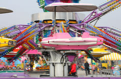 Nacelle of a carousel as it spins wildly Royalty Free Stock Photography