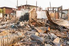 Nach Feuer im Elendsviertel Stockbild