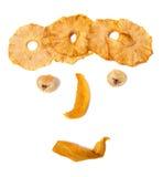 Nachahmung des menschlichen Gesichtes mit getrockneten Früchten Lizenzfreies Stockfoto