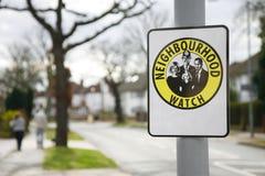 Nachbarschaftswache-Zeichen Stockbilder