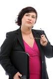Nachdenkliche Geschäftsfrau, die Entscheidungen trifft Lizenzfreie Stockfotografie