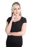 Nachdenkliche und fragend lokalisierte Geschäftsfrau im Porträt Stockfotos